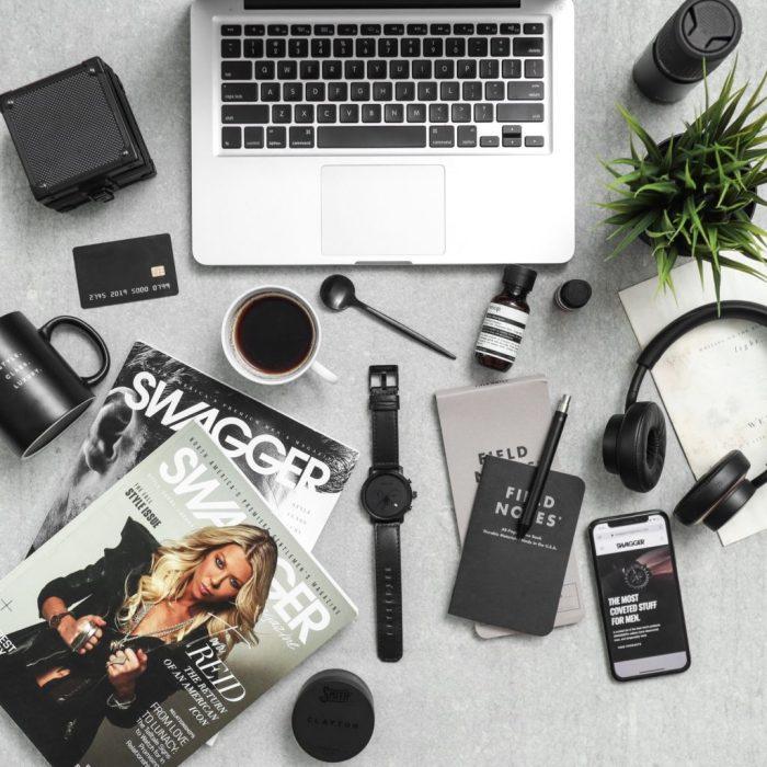 Macbook Pro Besides Dslr Camera and Mug
