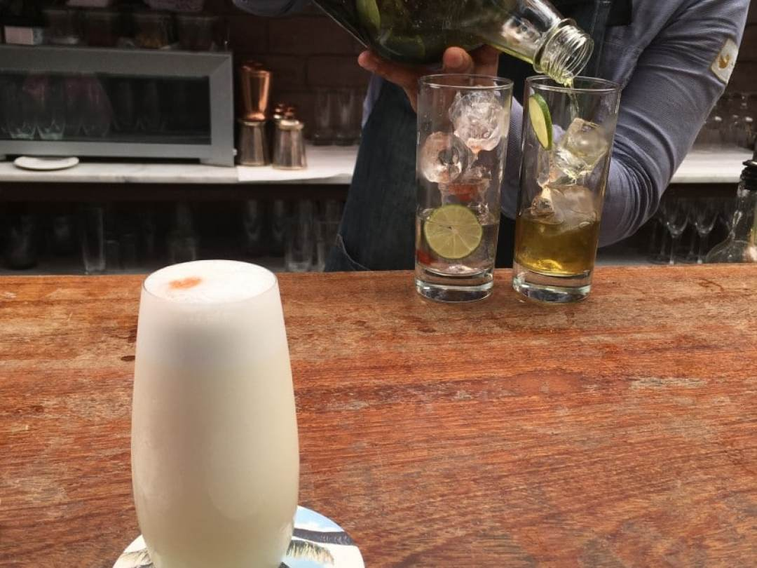 Cocktail Bar at El Mercado - Bartender Making a Pisco Sour