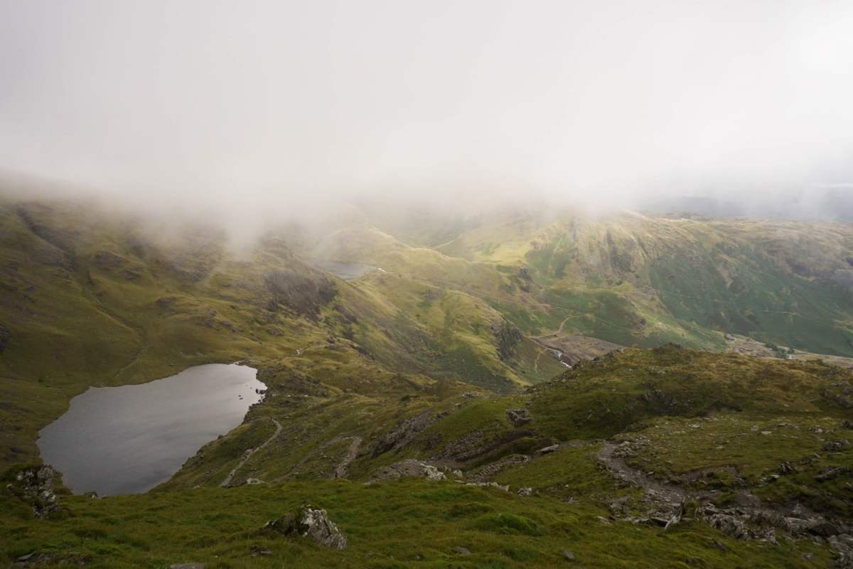 Lake District - Old Man of Coniston. Looking out over Low Water. Read our full guide to hiking in the Lake District.