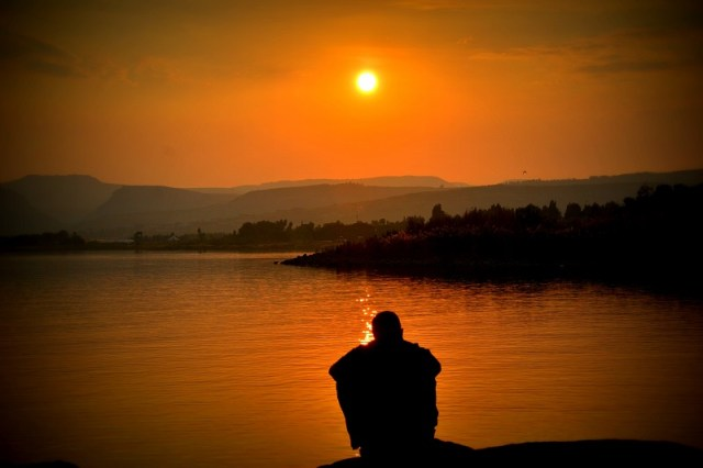 coping with guilt in addiction recovery man contemplating at sunset