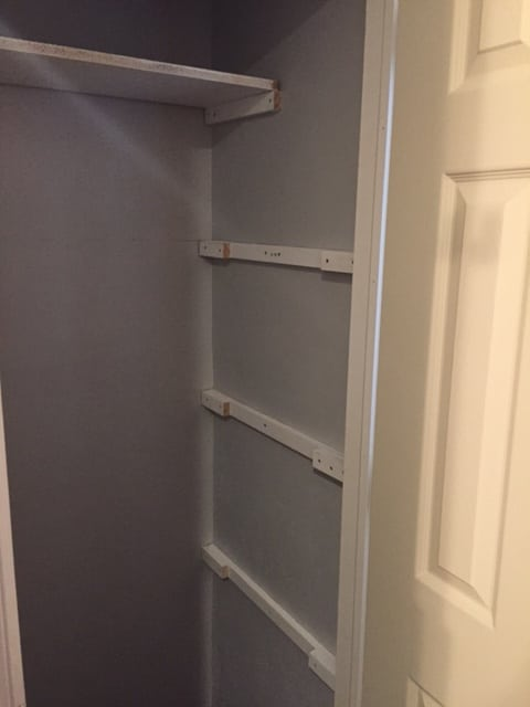 closet shelving - rails in place