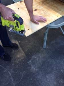 use a jigsaw to cut the plywood