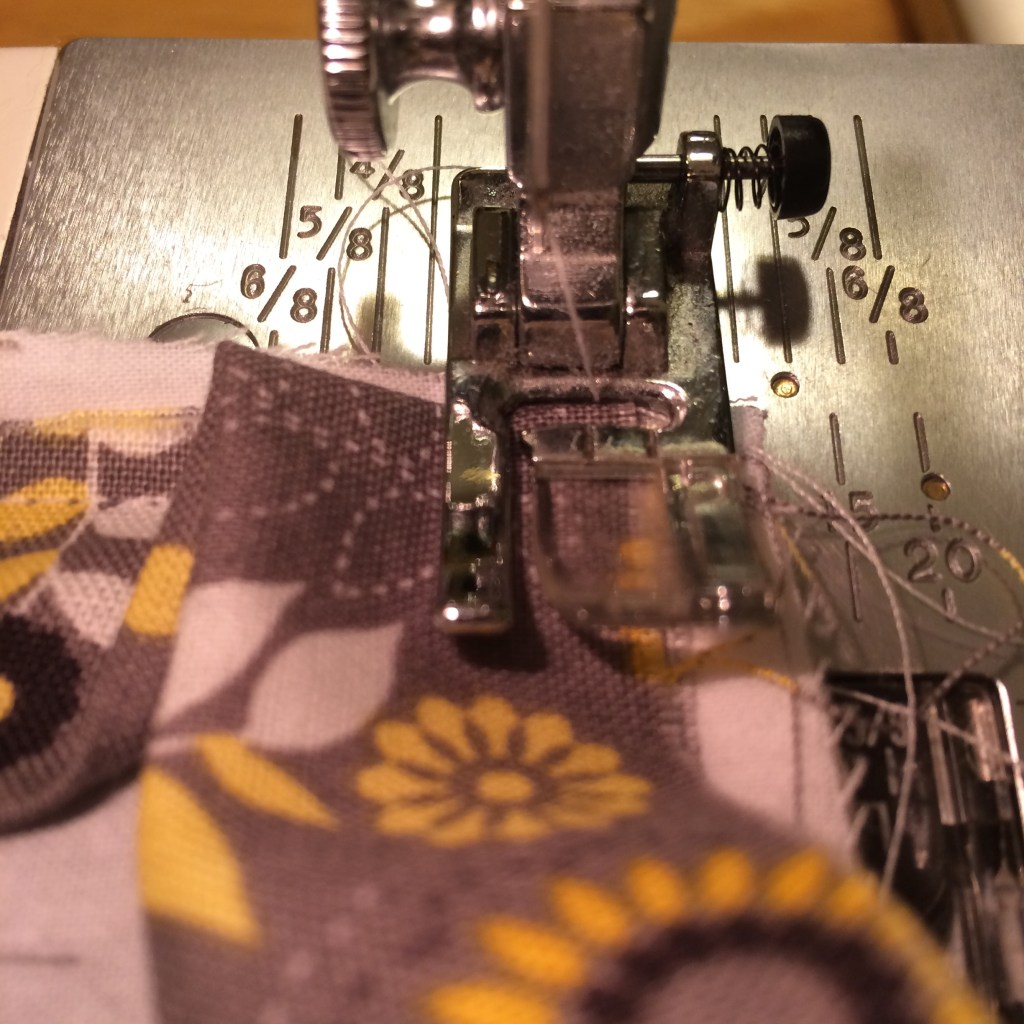 How to Sew an Ironing Pad   A Domestic Wildflower click through to read this tutorial for working with ironing board fabric and how to sew a mitered corner!