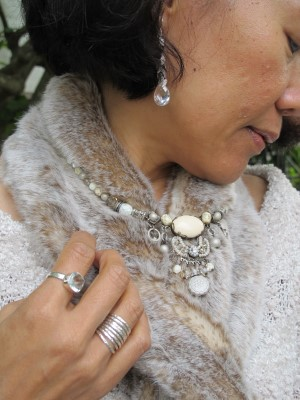 Wintery adornments, featuring Carmela Rose earrings, Sundance rings and necklace, and Restoration Hardware faux fur scarf.
