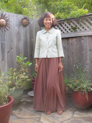 Going neutral with mint brocade and brown maxi skirt.