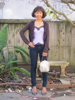 Another casual New Year's Eve, with a soft ruffled plum cardigan, silky camisole, vintage Whiting & Davis mesh purse, and silver metallic pumps.