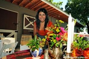 Pilar setting up floral arrangements for a wedding. (Photo credit: JRotsenphotography.com)