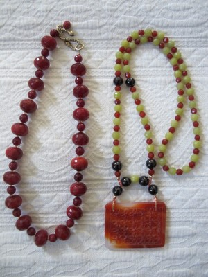 Early Carmela Rose pieces: Ruby quartz and glass with gold vermeil clasp (left) and carnelian, garnet, serpentine, glass, and 14k gold-filled (right).