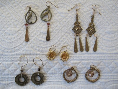 Vintage brass, tokens, garnet, Swarovski crystal, and 14k gold-filled hooks.