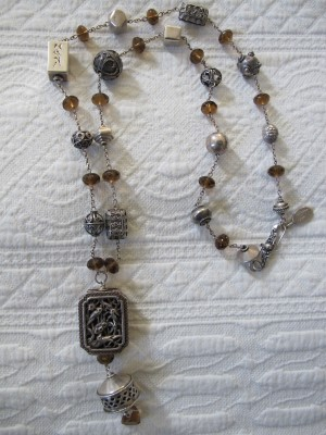 This necklace is one of my favorite Carmela Rose pieces: vintage sterling silver pieces mixed with oxidized sterling silver and Swarovski crystals.