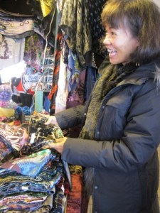 Admiring the scarves while being chatted up by the scarf lady.