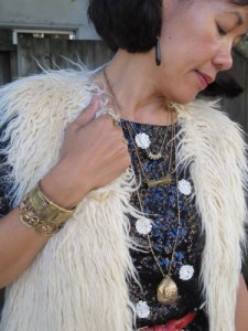 Adornments? Bring it on, piles of it. Mixing vintage (traveling walnut sewing kit from Treasury, Washington, D.C.), reclaimed vintage spider bracelet from M.E. Moore, and contemporary pieces (bow necklace from Gorgeous and Green, Berkeley, CA, and Art Deco scarab cuff from Alkemie, Los Angeles).