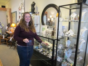 Kate Peterson arranges beautiful jewelry in their display cases.