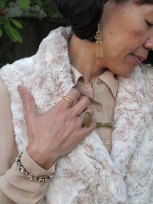 Reclaimed vintage gold jewelry looks natural against tan silk and creamy mottled faux fur.