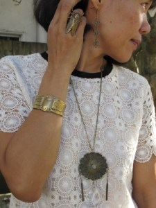 Accessorizing creamy lace with a Gorgeous and Green statement reclaimed vintage necklace (Berkeley, CA), End of Century cicada ring (NYC), Alkemie scarab cuff (Los Angeles), and Paz Sintes textile earrings (Spain).
