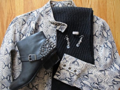 Faux snakeskin pattern can be overwhelming, so stick with an all-black outfit (simple knit dress, knit scarf, and tights), black booties with studs for added texture and interest, and simple silver jewelry.