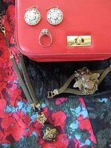 Combining florals, faux fur, red leather, insects, reclaimed vintage, and vintage jewelry.