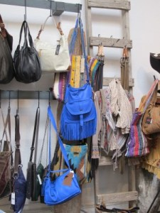 A great display of purses on a ladder.