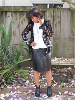This outfit has a beatnik sensibility to it: Vegan leather and real leather, lace and ruffles, reclaimed vintage jewelry, and black and white.