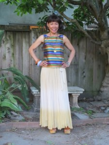 Another take on the striped blouse: A flowing maize-colored skirt makes the outfit more casual and summery.