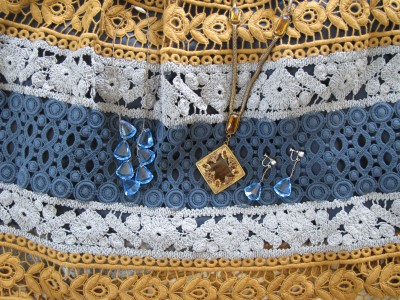 Vintage jewelry and summer dress close-up.