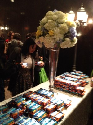 Gorgeous floral arrangements and stacks of Luna bars.