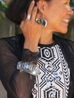 Against a backdrop of a sheer, crinkly jacket and Pendleton-like graphic print dress, I accessorized with an Anthropologie clear cuff, Lava 9 earrings (Berkeley, CA), BCBG MaxAzria faceted ring, and Sundance stack of rings.
