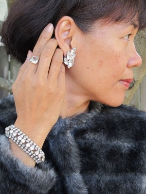 Evoking 1940s glamour with vintage bracelet (The Cleveland Shop, Cleveland, OH), eBay vintage Weiss clip-on earrings, and Sundance ring.
