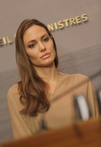 A contemplative Angelina Jolie - poised and elegant.