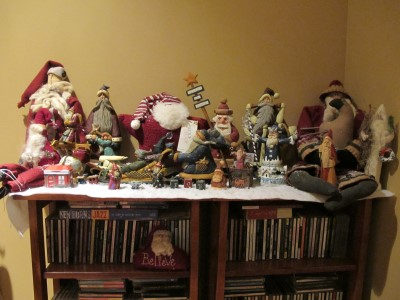 My curated Santa collection, which includes the white Santa on the far right from a trip to NYC's Folk Art Museum when I was in graduate school, a small carved Santa from Krakow in 2002, and another carved Santa from a trip to Colorado and the Rocky Mountains in 1993.