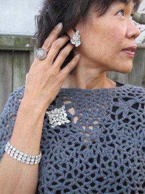 Vintage Eisenberg rhinestone bracelet, brooch, and clip-on earrings, and Elizabeth Ng antique button ring (Abacus, Portland, ME) over a Sundance crocheted capelet.