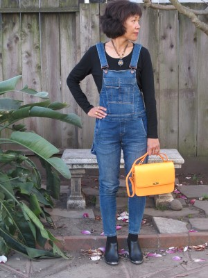 Hipster black and unexpected pop of neon orange elevate the very comfortable overalls.