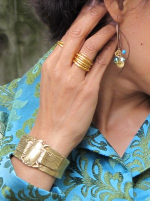 Perfect accessories to complement the vivid embroidery: Alkemie scarab cuff, Kate Peterson Designs stack of rings, and Lava 9 earrings (Berkeley, CA).