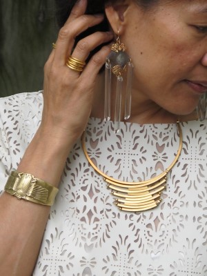 Against a creamy cut-out blouse: Anthropologie statement earrings, stack of rings by Kate Peterson Designs (El Cerrito, CA), Alkemie scarab cuff made of recycled metal, and Laura Lombardi necklace (Eskell, Chicago).