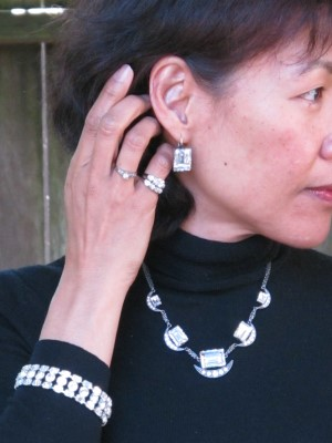 Icy jewelry pop against a black sweater: Earrings and matching necklace from Personal Pizazz (Berkeley, CA), vintage Eisenberg rhinestone bracelet (L'Armoire, Albany, CA), and my mother's wedding ring and band on my pinkie finger and ring that she gave me from her family in 1972.