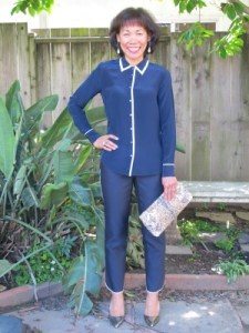 Pajama-style outfits are still trending. Regal navy with cream piping is a more subdued and classical version.