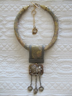 Silk Road series necklace made of Chinese quilin decoration and antique Japanese obi by Gretchen Schields.