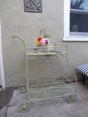 The new spot for the garden cart, awaiting tea towels, napkins, hanging wine glasses, and fine chocolates to go with the bouquet of flowers.