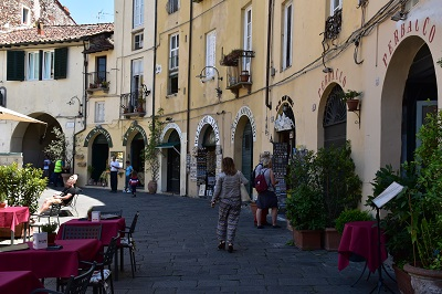Shops and restaurants line the inside of what used to be a Roman amphitheater.
