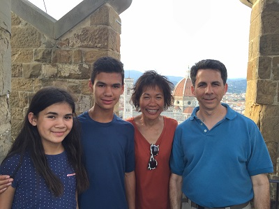 At the top of the tower of the Palazzo Vecchio with the Duomo in the background.
