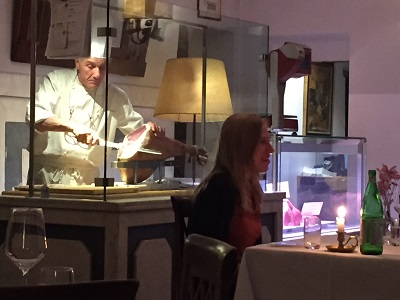 Chef slicing prosciutto.