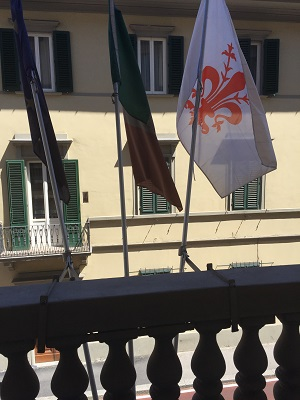 Our room with a view - three flags, one bearing the Firenze insignia.