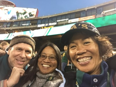 Tim, Janet, and me at the Oakland A's fireworks game. Tim took pleasure in entertained us by photo-bombing the group of women in front of us.