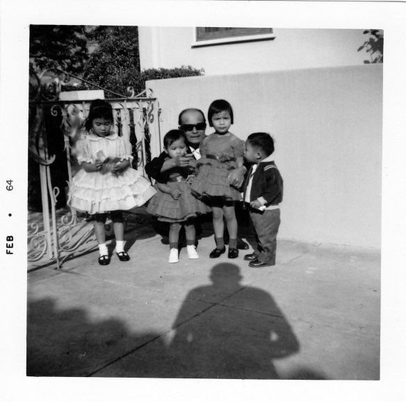 My sisters and cousin Arnold with the infamous Uncle Peanut in the courtyard of our house on Rogers Street. That's the shadow of my father taking our picture.