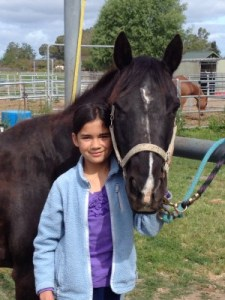 May 2014, Isabella and her love of horses.