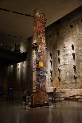 The 36-foot Last Column is covered with memorial inscriptions, mementos, and missing posters affixed by rescue workers, ironworkers, and others (photo by David).