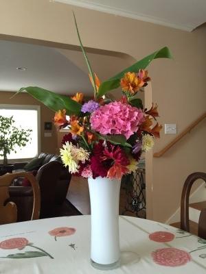 Ginger plant, hydrangea, alstroemeria, dianthus, and dahlia bouquet.