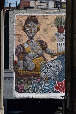 Art on buildings in between buildings (photo by David).