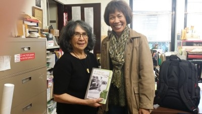Auntie Dorothy and me with my novel (photo courtesy of Maria Batayola).