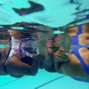Under water with members of the synchronized swim team.